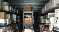 Indianapolis Document Shredding Services image shows lots of cardboard boxes stored on shelves.